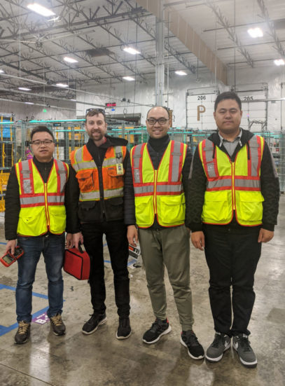 Jesse Frame and Integ-Ops team in safety vests at warehouse